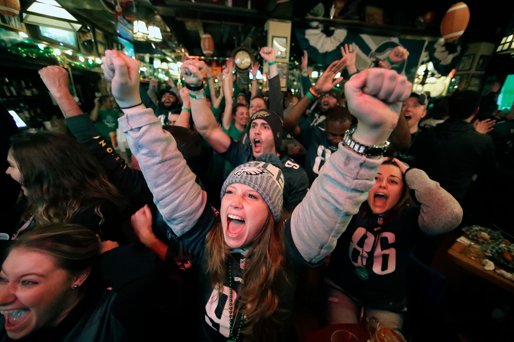 . Philadelphia Eagles fans in Philadelphia react while watching the first quarter of the NFL Super Bowl 52 football game between the Eagles and the New England Patriots in Minneapolis, Sunday, Feb. 4, 2018. (AP Photo/Matt Rourke)