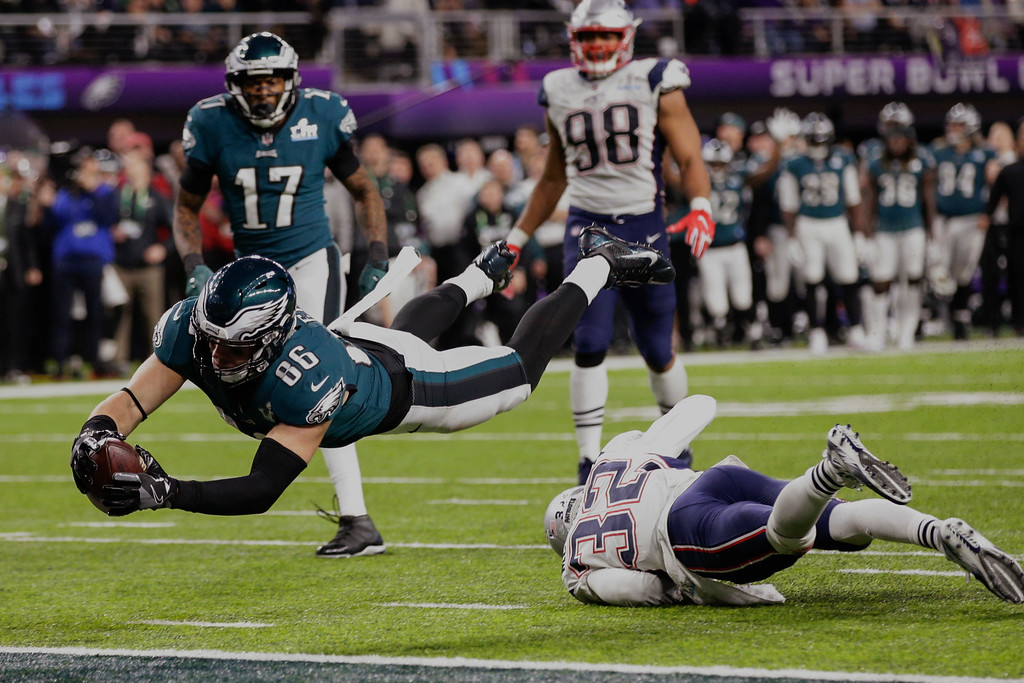 . Philadelphia Eagles tight end Zach Ertz (86) dives into the end zone over New England Patriots free safety Devin McCourty (32) for a touchdown, during the second half of the NFL Super Bowl 52 football game against the New England Patriots, Sunday, Feb. 4, 2018, in Minneapolis. (AP Photo/Frank Franklin II)