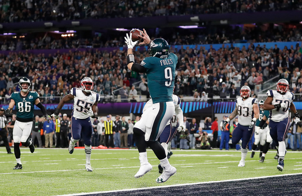 . Philadelphia Eagles\' Nick Foles catches a touchdown pass during the first half of the NFL Super Bowl 52 football game against the New England Patriots Sunday, Feb. 4, 2018, in Minneapolis. (AP Photo/Jeff Roberson)