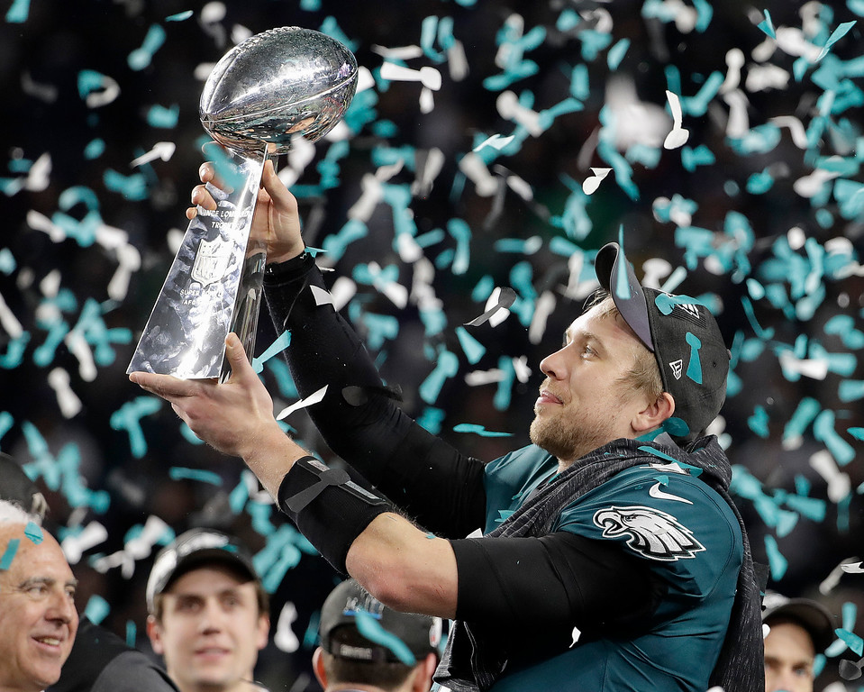 . Philadelphia Eagles\' Nick Foles holds up the Vince Lombardi Trophy after the NFL Super Bowl 52 football game against the New England Patriots, Sunday, Feb. 4, 2018, in Minneapolis. The Eagles won 41-33. (AP Photo/Chris O\'Meara)