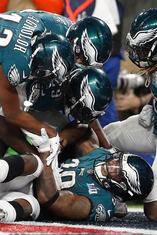 . Philadelphia Eagles\' Corey Clement, bottom, celebrates his touchdown catch during the second half of the NFL Super Bowl 52 football game against the New England Patriots Sunday, Feb. 4, 2018, in Minneapolis. (AP Photo/Jeff Roberson)