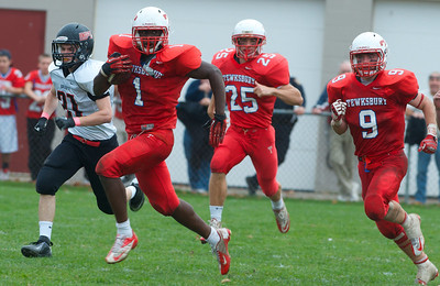 102712, Tewksbury, MA - Tewksbury's Eddie Matovu (1) sprints downfiled past North Andover's Daniel Waddle (31) as teammate Blake Hery (25) and Tom Casey (9) follow during Saturday's game. Herald photo by Ryan Hutton