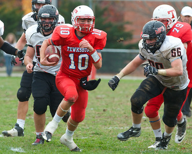 102712, Tewksbury, MA - Tewksbury's Johnny Aylward (10) dashes past North Andover's Nate Hitchcock (56) during Saturday's game. Herald photo by Ryan Hutton
