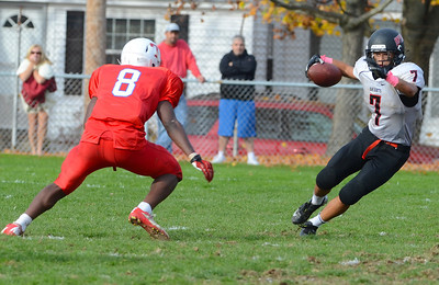 102712, Tewksbury, MA - North Andover's Robert Shkliew (7) maneuvers past Tewksbury's Eddie Matovu (8) during Saturday's game. Herald photo by Ryan Hutton