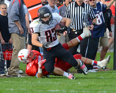 102712, Tewksbury, MA - North Andover's Tyler Whitley (83) gets taken down by Tewksbury's Dominic Rosado (27) during Saturday's game. Herald photo by Ryan Hutton