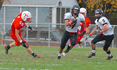 102712, Tewksbury, MA - North Andover's Robert Shkliew (7) carries the ball past Tewksbury's Tim Martel (59), his teammate Tyler Salois (9) looks on during Saturday's game. Herald photo by Ryan Hutton