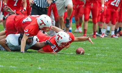 102712, Tewksbury, MA - Tewksbury's Anthony Monteneri (83) recovers a North Andover fumble from Matt Iacoviello (54) with the help of teammate Roy Felix (24) with 21 seconds to go in the first half of Saturday's game. Herald photo by Ryan Hutton