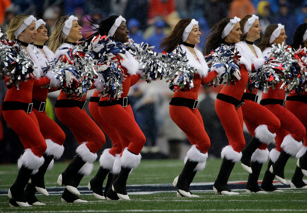 new england patriots cheerleaders perform wearing christmas outfits before an nfl football game between the - Football Christmas Eve
