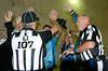 Sep 30, 2012; Detroit, MI, USA; NFl referees Ron Marinucci (107) and Garth Defelice (53) celebrate with fans before the game between the Detroit Lions and the Minnesota Vikings at Ford Field. Mandatory Credit: Tim Fuller-US PRESSWIRE