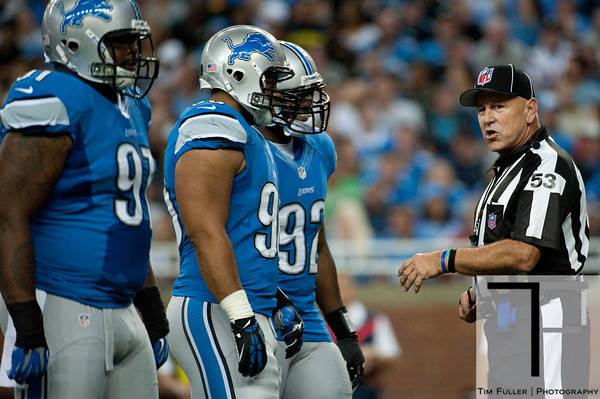 Sep 30, 2012; Detroit, MI, USA; NFL referee Garth Defelice (53) talks to Detroit Lions defensive tackle Ndamukong Suh (second from left)during the second quarter against the Minnesota Vikings at Ford Field. Mandatory Credit: Tim Fuller-US PRESSWIRE