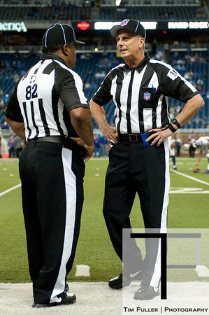 Sep 30, 2012; Detroit, MI, USA; NFL referees Buddy Horton (82) and Ron Marinucci (107) talk before the game between the Detroit Lions and the Minnesota Vikings at Ford Field. Mandatory Credit: Tim Fuller-US PRESSWIRE