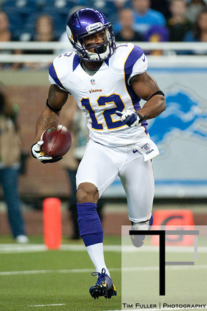 Sep 30, 2012; Detroit, MI, USA; Minnesota Vikings wide receiver Percy Harvin (12) runs the ball during the first quarter against the Detroit Lions at Ford Field. Mandatory Credit: Tim Fuller-US PRESSWIRE