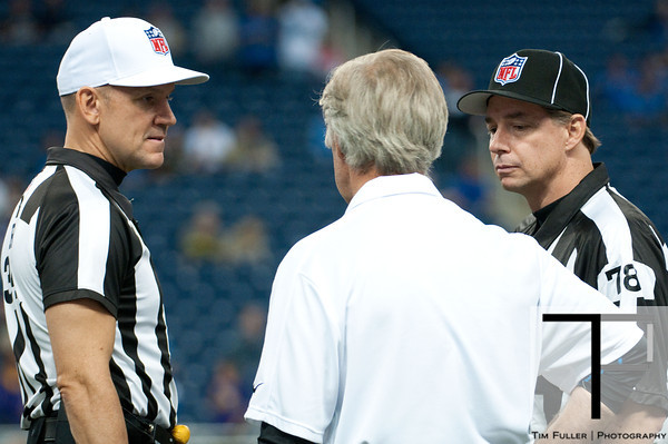 Sep 30, 2012; Detroit, MI, USA; NFL referees Clete Blakeman (34) and Tony Meyer (78) talk to Detroit Lions assistant head coach and defensive coordinator before the game against the Minnesota Vikings at Ford Field. Mandatory Credit: Tim Fuller-US PRESSWIRE