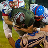 Warriors Austin Brandt (23) is wrapped up by Comets Gavin Hickle (44) Colton Welker (35) and Kasey Ault (40) in the second half. Winamac went on to defeat Caston by a score of 47-8. Fran Ruchalski | Pharos-Tribune
