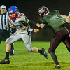 Comets Brady Hartman (20) has ahold of Warriors Carson Despot (11) by the jersey who has a grip on Comets Kasey Ault (40) jersey in the second half. Winamac went on to defeat Caston by a score of 47-8. Fran Ruchalski | Pharos-Tribune