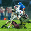 Warriors Dylan Fox (36) brings down Comets quarterback Brandon Kinser (9) in the first half. Winamac went on to defeat Caston by a score of 47-8. Fran Ruchalski | Pharos-Tribune