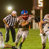 Comets Kasey Ault (40) runs through the line in the second half. Winamac went on to defeat Caston by a score of 47-8. Fran Ruchalski | Pharos-Tribune