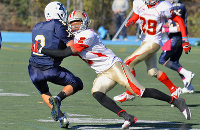101312, Westwood, MA - Everett's Jakarrie Washington, right, takes down Xaverian's AJ King. Herald photo by Ryan Hutton.