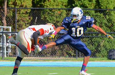 101312, Westwood, MA - Everett's Jakarrie Washington intercepts a pass intended for Xaverian's DJ Pagliuca, right. Herald photo by Ryan Hutton.