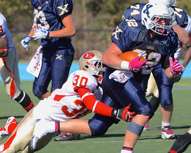 101312, Westwood, MA - Everett's C.J. Pavelus wraps Xaverian's Shayne Kaminski. Herald photo by Ryan Hutton.
