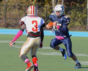 101312, Westwood, MA - Xaverian quarterback Austin DeCarr keeps the ball and tries to carry it past Everett's Jalen Felix. Herald photo by Ryan Hutton.