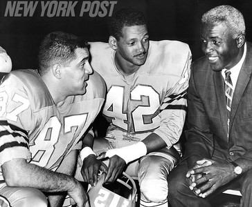 Jackie Robinson Speaks to Football Players. 1966