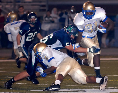 11-02-07  --mceachern at harrison 03--  Harrison's Carl Shubert (56) gets a piece of McEachern's Rajaan Bennett (31) Friday night.  PHOTO BY LAURA MOON.