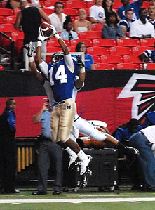 08-21-10  --peachtree ridge at mceachern 01--  McEachern's DeNard Ford makes the interception near the end zone to rob Peachtree Ridge of a touchdown on Saturday night.  STAFF/LAURA MOON.