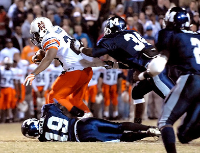 11-09-07  --north cobb at marietta 02-- Senior running back Calvin Middleton (20) attempts to gain a few more yards as Marietta's Marcas Cothran (34) and Hasaan Green (19) pull him down.  PHOTO BY LAURA MOON.