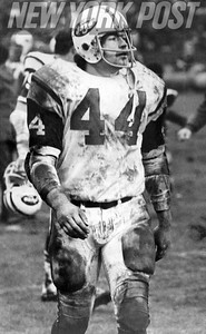 Pro Football Hall of Famer John Riggins #44 has a great muddy game for the NY Jets. 1971