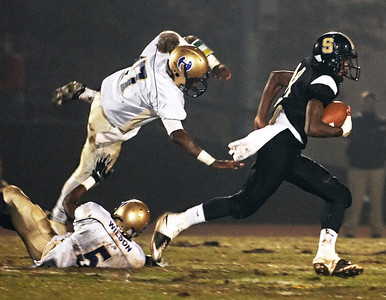 10-30-09  --hiram at sprayberry 06--  Sprayberry's D.J. Funderburg, right, gains yards for the Yellow Jackets as Hiram attempts to dive for him on Friday night.  STAFF/LAURA MOON.