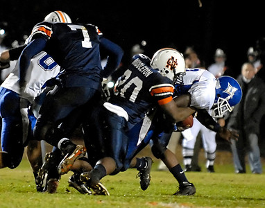 North Cobb's Calvin Middleton (20) brings down Peachtree Ridge's Asher Clark (2) Friday night.