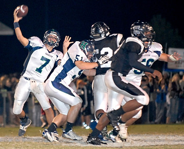 10-19-07  --Harrison at Kennesaw Mountain 03--  Harrison's quarterback Christian Burnett (7) releases the ball to an open teammate Friday night against Kennesaw Mountain High School.  PHOTO BY LAURA MOON.