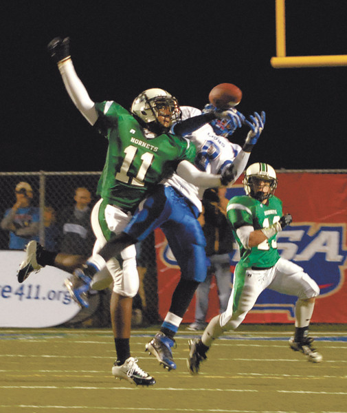 Garrett Embry attempts an interception at the State Finals against Peachtree Ridge at McEachern High School.