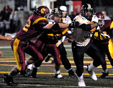 10-12-07  --sprayberry at lassiter 03--  Junior running back David Carter (32) avoids the grasp of the Lassiter defense Friday night.  PHOTO BY LAURA MOON.