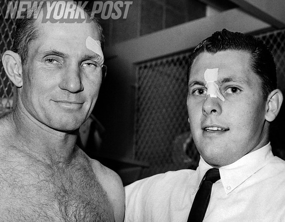 New York Giants Y. A. Tittle and Lineman Ken Byers show off their battle scars. 1963