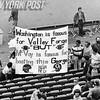 Washington Football Fan Holding Sign. 1977.
