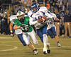 Zack Waddle attempts to get a piece of McEachern's quarterback as they battle for the state title.