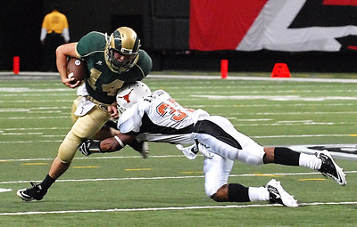 08-21-10  --grayson at kell 03--  Kell's Brian Randolph (37) gives Grayson's Devin Gillespie (14) a big hit to bring him down on Saturday afternoon.  STAFF/LAURA MOON.