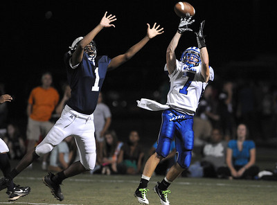 2010-09-03 -- ncc at mount paran -- Mount Paran's Landon Bentley (7) pulls down the touchdown pass over North Cobb Christian's Stephon Jelks (1) in Friday night's game. Staff/Anthony Stalcup