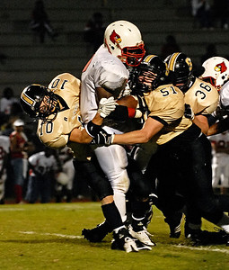 10-02-09  --osborne at sprayberry 06--  Sprayberry's Blake Young (10) and Conner Porter (51) work together to stop Osborne's Emmitt Rice from gaining yards on Friday night.  STAFF/LAURA MOON.