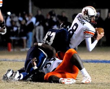 11-09-07  --north cobb at marietta 03-- Marietta's Josh Garrett (63) sacks North Cobb's quarterback Matt Roark during Friday night's game.  PHOTO BY LAURA MOON.