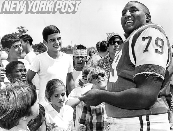 Sherman Plunkett of the New York Jets at spring training with his admirers. 1968