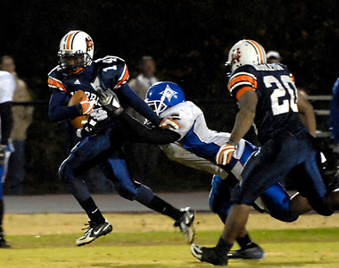 11-16-07  --peachtree ridge at north cobb 04--  North Cobb junior Michael Emerson (14) tries to fend off Kevin Minter (7) to gain more yards during the match up against Peachtree Ridge.  PHOTO BY LAURA MOON.