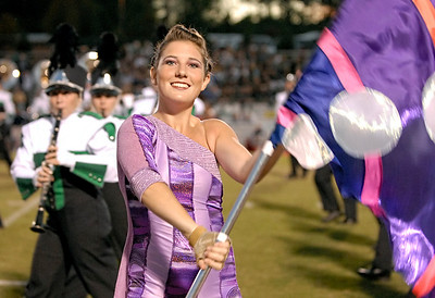 10-19-07  --Harrison at Kennesaw Mountain Feature 04--  Senior color guard Hannah Cutcliff performs with the Harrison High School Marching Band during a pregame show at Kennesaw Mountain Friday night.  PHOTO BY LAURA MOON.