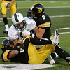 Record-Eagle/Keith King<br /> Traverse City Central's Boone Marois, top, and Dylan Roe, bottom, take down Alpena's Tyler Kirkwood Friday, September 10, 2010 at Thirlby Field.