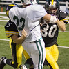 Record-Eagle/Keith King<br /> Traverse City Central's Dylan Roe, right, and Brandon McKee, left, try to tackle Alpena's Austin Leeck Friday, September 10, 2010 at Thirlby Field.