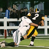 Record-Eagle/Keith King<br /> Traverse City Central's Tim Martin, right, fights for extra yards against Alpena's Anthony Garant Friday, September 10, 2010 at Thirlby Field.