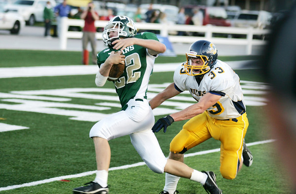 Record-Eagle/Keith King<br /> Traverse City West's Zac Shafer eludes Cadillac's Mike Weeks for a touchdown Friday, September 17, 2010 at Thirlby Field.