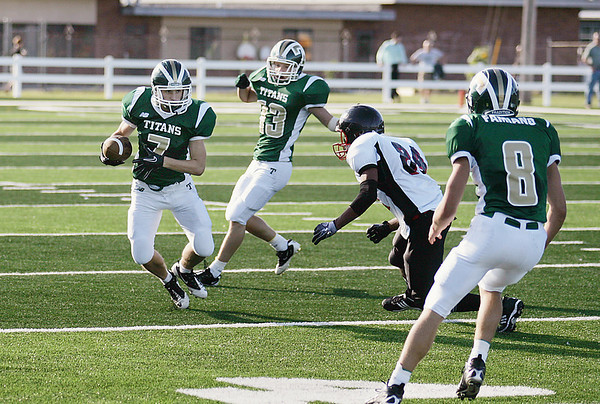 Record-Eagle/Keith King<br /> Traverse City West's Ryan Peters runs the ball after catching an interception against Essex Friday, September 10, 2010 at Thirlby Field.